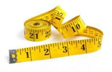 measure tape to measure a machine belt